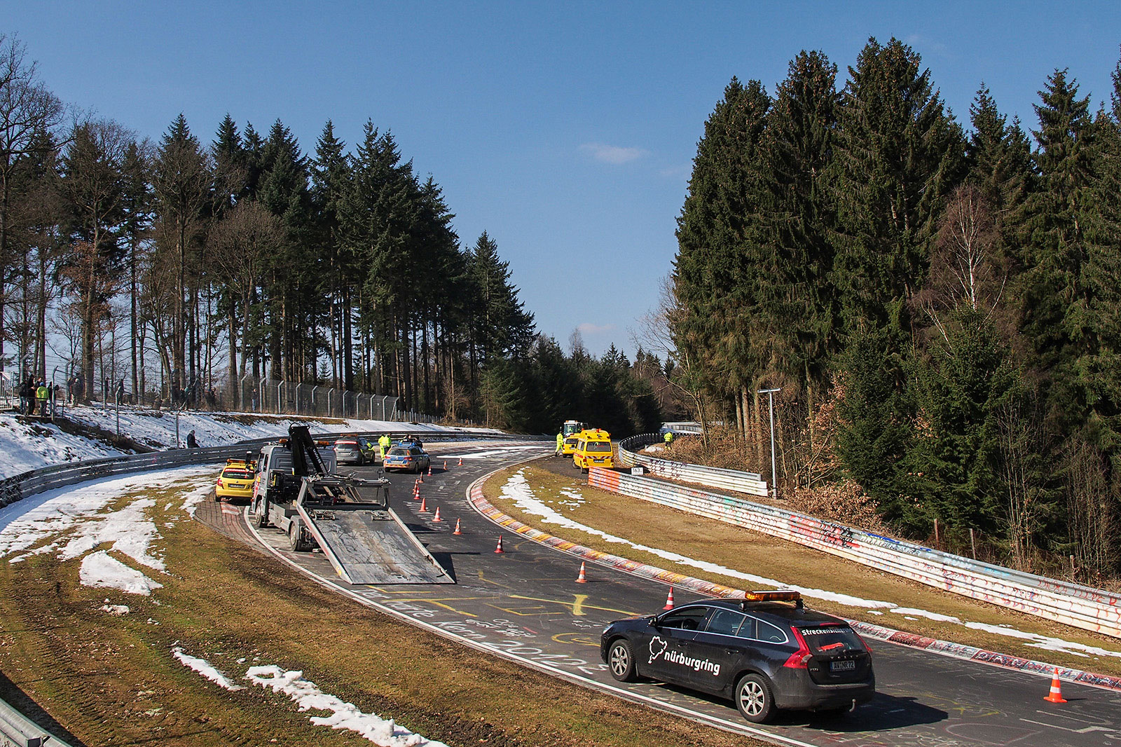 Nürburgring staff trying to work out what to do about a graffiti doodle. Also note the amount of snow still surrounding the track. Photo by Meaghan O'Brien.